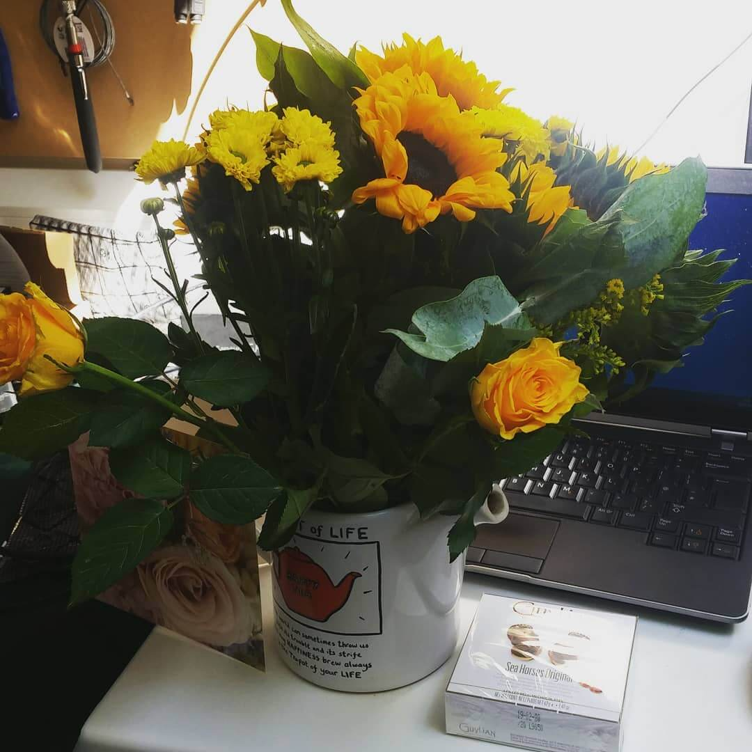 Another day, another unexpected gift from another happy customer! This one's a first here at NJPC towers, and as you can see, we're not exactly prepared for flowers! Hey, this is Brighton. Everyone uses teapots as vases round here